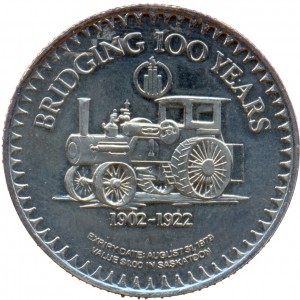 "The coin's reverse featured an antique tractor beneath the inscription ""BRIDGING 100 YEARS"" and above the dates ""1902-1922"", during which Saskatoon experienced exponential growth."