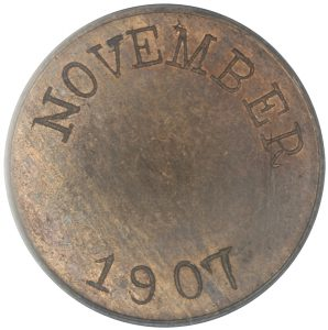 "One side of the 1907 trial tokens read ""NOVEMBER / 1907"". (Photo by PCGS)"